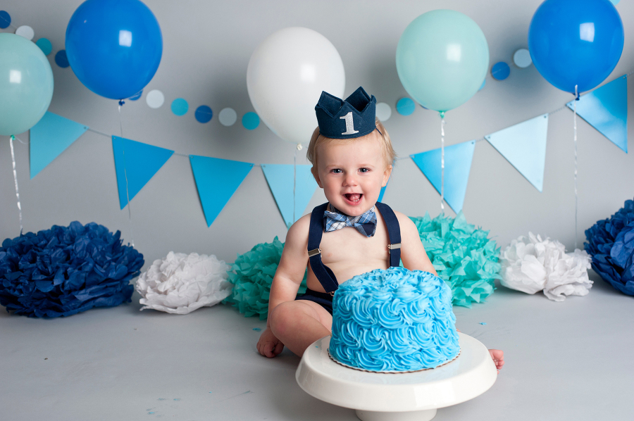 Long Island Cake Smash Studio Photographs 1 Year Old Boy In Bowtie Suspenders And Navy Crown