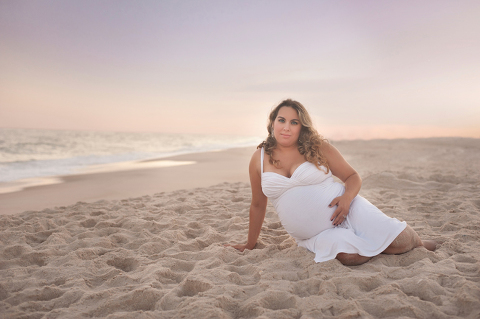 maternity photo of mother to be in white dress on long island beach