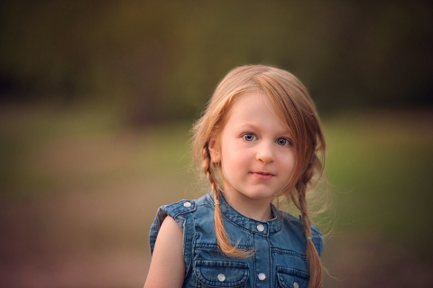 4 year old strawberry blonde farm girl with denim and pig tail braids
