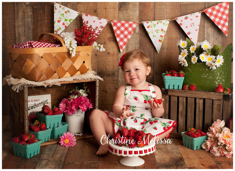 2 Year Old Girl Smiling With Red Bow And Cake Plate Of Strawberries In Long Island